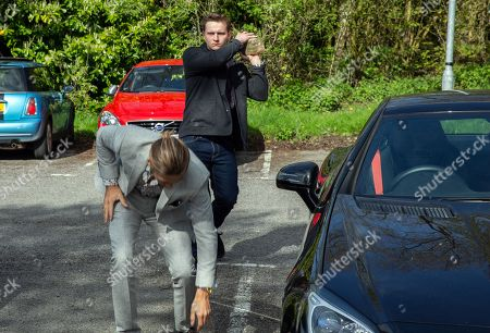 Stock Photo of Ep 8184 & Ep 8185 Friday 22nd June 2018 When Freddy, as played by Jamie Bacon, parks at a hotel Lachlan White, as played by Thomas Atkinson, gets out of the car, preparing to attack him....