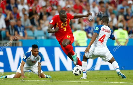 Belgium's Romelu Lukaku, center, Panama's Fidel Escobar, right, and Panama's Eric Davis, left, challenge for the ball during the group G match between Belgium and Panama at the 2018 soccer World Cup in the Fisht Stadium in Sochi, Russia