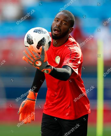 Senegal goalkeeper Alfred Gomis control the ball during Senegal's official training on the eve of the group H match between Poland and Senegal at the 2018 soccer World Cup in the Spartak Stadium in Moscow, Russia