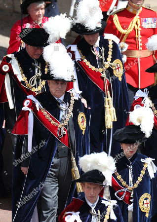 Prince Edward, Duke of Kent (Front-L), Princess Anne (Front-R), Prince Andrew (Center-L), Prince Charles (Back-L) and Prince William (Back-R) march during the Order Of The Garter Service at Windsor Castle