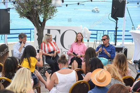 Stock Photo of 65th Cannes Lions. From left, Marc Pritchard, Procter & Gamble, MILCK, artist, Emma Reeves, Free the Bid, and Antonio Lucio from HP Inc take part in a discussion at the The Girls Lounge at the Martinez Hotel, in Cannes, France