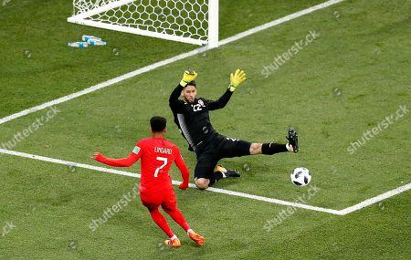Jesse Lingard of England and Goalkeeper Mouez Hassen of Tunisia
