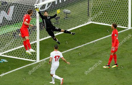 Harry Kane of England and Goalkeeper Mouez Hassen of Tunisia