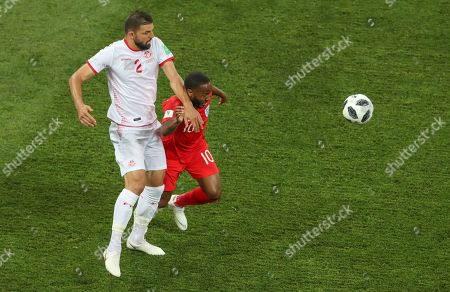 England's Raheem Sterling is dwarfed by Tunisia's Syam Ben Youssef