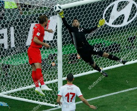Tunisia goalkeeper Mouez Hassen, right, and England's Harry Kane fight for the ball during the group G match between Tunisia and England at the 2018 soccer World Cup in the Volgograd Arena in Volgograd, Russia