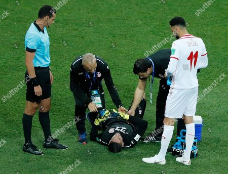 Tunisia goalkeeper Mouez Hassen is injured during the group G match between Tunisia and England at the 2018 soccer World Cup in the Volgograd Arena in Volgograd, Russia