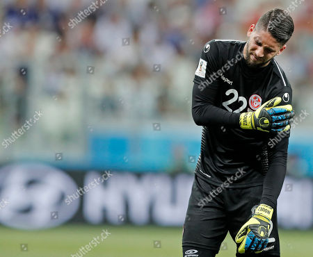 Tunisia goalkeeper Mouez Hassen has to leave the pitch injured during the group G match between Tunisia and England at the 2018 soccer World Cup in the Volgograd Arena in Volgograd, Russia