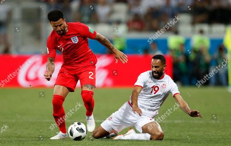 Stock Photo of England's Kyle Walker and Tunisia's Saber Khalifa challenge for the ball during the group G match between Tunisia and England at the 2018 soccer World Cup in the Volgograd Arena in Volgograd, Russia