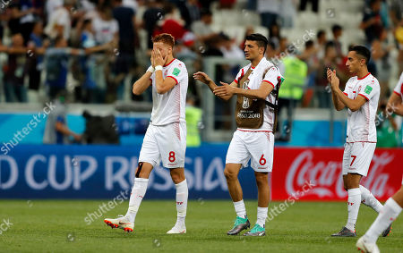 Tunisia's Fakhreddine Ben Youssef, Rami Bedoui and Saifeddine Khaoui leave the pitch disappointed after losing the group G match between Tunisia and England at the 2018 soccer World Cup in the Volgograd Arena in Volgograd, Russia