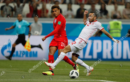 England's Dele Alli, left, and Tunisia's Ali Maaloul challenge for the ball during the group G match between Tunisia and England at the 2018 soccer World Cup in the Volgograd Arena in Volgograd, Russia