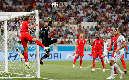 Tunisia goalkeeper Mouez Hassen jumps for the ball during the group G match between Tunisia and England at the 2018 soccer World Cup in the Volgograd Arena in Volgograd, Russia