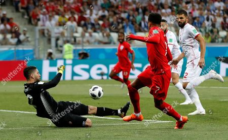 England's Jesse Lingard passes the ball in front of Tunisia goalkeeper Mouez Hassen during the group G match between Tunisia and England at the 2018 soccer World Cup in the Volgograd Arena in Volgograd, Russia