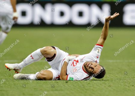 Tunisia's Ali Maaloul writhes in pain after collision with England's Kieran Trippier during the group G match between Tunisia and England at the 2018 soccer World Cup in the Volgograd Arena in Volgograd, Russia