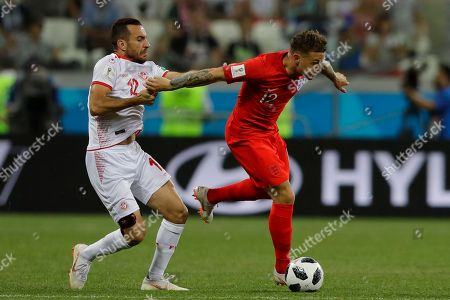 England's Kieran Trippier, right, and Tunisia's Ali Maaloul scuffle during a group G match at the 2018 soccer World Cup in the Volgograd Arena in Volgograd, Russia