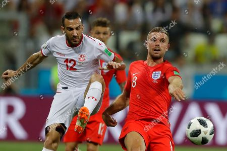 Tunisia's Ali Maaloul, left, and England's Jordan Henderson fight for the ball during the group G match between Tunisia and England at the 2018 soccer World Cup in the Volgograd Arena in Volgograd, Russia
