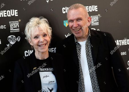 "Director Tonie Marshall and fashion designer Jean Paul Gaultier pose before the premiere of the film "" Un couteau dans le coeur"", in Paris"