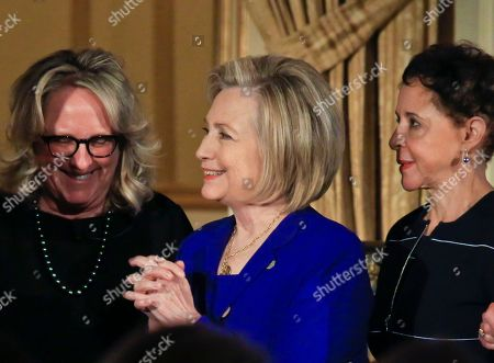 Hillary Clinton, Sheila Johnson, Deirdre Quinn. Former U.S. Secretary of State Hillary Clinton, center, stands between Sheila Johnson, right, founder and CEO of Salamander Hotels and Resorts and BET co-founder, and Deirdre Quinn, left, CEO and co-founder of Lafayette 148 New York, after they received the 2018 Elly Award, in New York