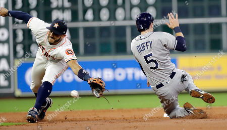 Carlos Correa, Matt Duffy. Tampa Bay Rays' Matt Duffy (5) steals second base as the throw from Houston Astros catcher Brian McCann gets past shortstop Carlos Correa, left, during the third inning of a baseball game, in Houston. Duffy advanced to third on McCann's throwing error