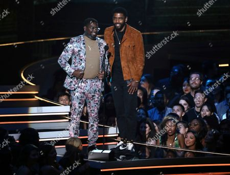Lil Rey Howery and Kyrie Irving. Lil Rey Howery, left, and Kyrie Irving present the most frightened performance award at the MTV Movie and TV Awards at the Barker Hangar, in Santa Monica, Calif