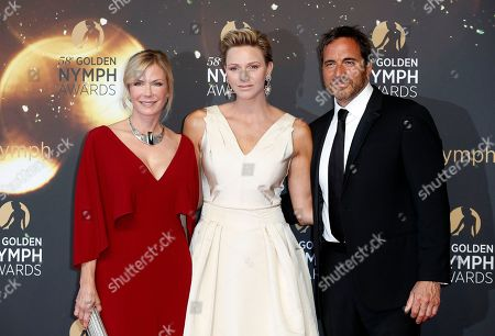 Princess Charlene of Monaco (C) poses with US actors Katherine Kelly Lang (L) and Thorsten Kaye (R) on the red carpet while arriving for the closing ceremony of the 58th Monte Carlo Television Festival in Monaco, 19 June 2018. The event will take place from 15 to 19 June.
