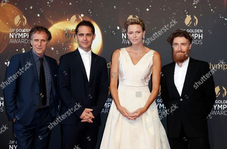 Princess Charlene of Monaco (2-R) poses with Spanish actor Pedro Alonso (2-L), French actors Charles Berling (L) and Thierry Fremont (R) pose on the red carpet while arriving for the closing ceremony of the 58th Monte Carlo Television Festival in Monaco, 19 June 2018. The event will take place from 15 to 19 June.