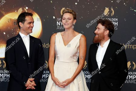Princess Charlene of Monaco (C) poses with Spanish actor Pedro Alonso (L) and French actor Thierry Fremont (R) on the red carpet while arriving for the closing ceremony of the 58th Monte Carlo Television Festival in Monaco, 19 June 2018. The event will take place from 15 to 19 June.