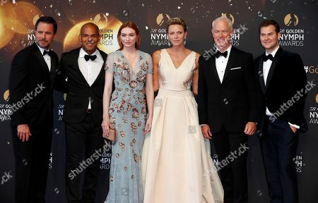 Princess Charlene of Monaco (3-R) poses with US actors Charles Esten (L), Neal McDonough (2-R), Justin Prentice (R), Puerto Rican actor Amaury Nolasco (2-L) and British actress Eleanor Tomlinson (3-L) pose on the red carpet while arriving for the closing ceremony of the 58th Monte Carlo Television Festival in Monaco, 19 June 2018. The event will take place from 15 to 19 June.