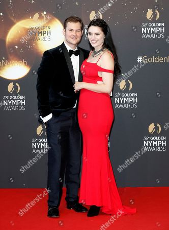 US actor Justin Prentice (L) and his girlfriend Annika (R) pose on the red carpet while arriving for the closing ceremony of the 58th Monte Carlo Television Festival in Monaco, 19 June 2018. The event will take place from 15 to 19 June.