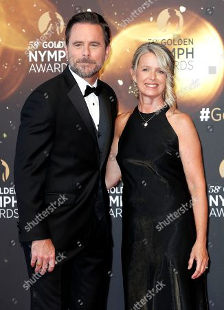 US actors Charles Esten (L) and Patty Hanson (R) pose on the red carpet while arriving for the closing ceremony of the 58th Monte Carlo Television Festival in Monaco, 19 June 2018. The event will take place from 15 to 19 June.