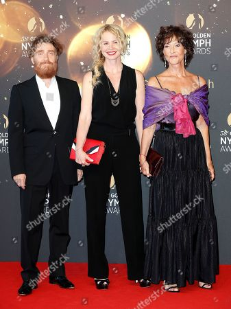 French actors Thierry Fremont (L), Carole Richert (C) and Chrystelle Labaude (R) pose on the red carpet while arriving for the closing ceremony of the 58th Monte Carlo Television Festival in Monaco, 19 June 2018. The event will take place from 15 to 19 June.