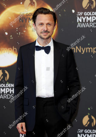French artist Martin Solveig poses on the red carpet while arriving for the closing ceremony of the 58th Monte Carlo Television Festival in Monaco, 19 June 2018. The event will take place from 15 to 19 June.
