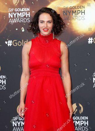 British actress Jessica Brown Findlay poses on the red carpet while arriving for the closing ceremony of the 58th Monte Carlo Television Festival in Monaco, 19 June 2018. The event will take place from 15 to 19 June.