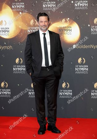 US actor Billy Campbell poses on the red carpet while arriving for the closing ceremony of the 58th Monte Carlo Television Festival in Monaco, 19 June 2018. The event will take place from 15 to 19 June.