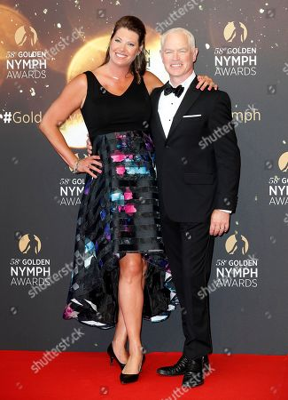 Neal McDonough (R) and his wife Ruve McDonough (L) pose on the red carpet while arriving for the closing ceremony of the 58th Monte Carlo Television Festival in Monaco, 19 June 2018. The event will take place from 15 to 19 June.