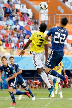 Oscar Murillo (L) of Colombia and Maya Yoshida of Japan in action during the FIFA World Cup 2018 group H preliminary round soccer match between Colombia and Japan in Saransk, Russia, 19 June 2018. (RESTRICTIONS APPLY: Editorial Use Only, not used in association with any commercial entity - Images must not be used in any form of alert service or push service of any kind including via mobile alert services, downloads to mobile devices or MMS messaging - Images must appear as still images and must not emulate match action video footage - No alteration is made to, and no text or image is superimposed over, any published image which: (a) intentionally obscures or removes a sponsor identification image; or (b) adds or overlays the commercial identification of any third party which is not officially associated with the FIFA World Cup)