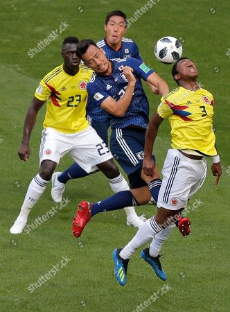 Japan's Maya Yoshida, left, and Colombia's Oscar Murillo, right, go for a header during the group H match between Colombia and Japan at the 2018 soccer World Cup in the Mordavia Arena in Saransk, Russia