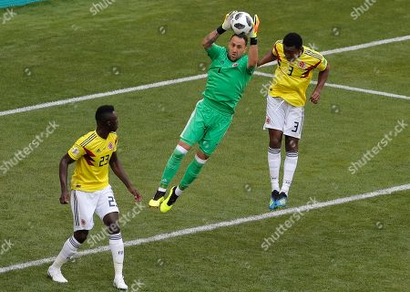 Colombia goalkeeper David Ospina, center, with his teammates Oscar Murillo, right, and Davinson Sanchez, left, make a save during the group H match between Colombia and Japan at the 2018 soccer World Cup in the Mordavia Arena in Saransk, Russia