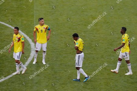 Colombia's Carlos Bacca, left, Radamel Falcao, 2nd left, Oscar Murillo, 2nd right, and Mateus Uribe, right, leave the pitch after loosing the group H match between Colombia and Japan at the 2018 soccer World Cup in the Mordavia Arena in Saransk, Russia