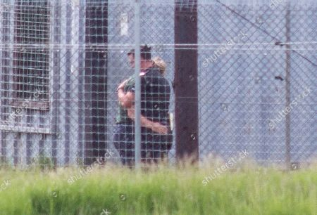 Police Forensic Officer Inspecting The Cage With A Zoo Worker Who Was Visibly Upset At Hamerton Zoo In Cambridgeshire Where 33 Years Old Zoo Keeper Rosa King Was Killed By A Tiger. 01.06.2017.