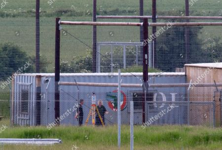 Police Forensic Officer Inspecting The Cage With A Zoo Worker Who Visible Upset At Hamerton Zoo In Cambridgeshire Where 33 Years Old Zoo Keeper Rosa King Was Killed By A Tiger. 01.06.2017.