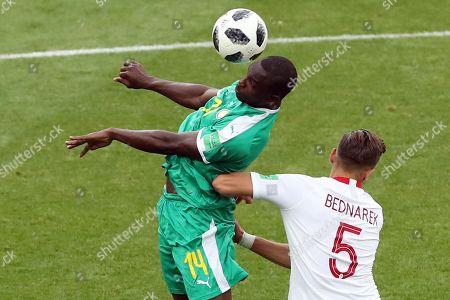 Moussa Konate of Senegal and Jan Bednarek of Poland