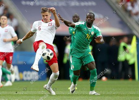 Jan Bednarek of Poland and Moussa Konate of Senegal