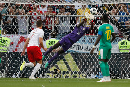 Senegal goalkeeper Khadim Ndiaye makes a save during the group H match between Poland and Senegal at the 2018 soccer World Cup in the Spartak Stadium in Moscow, Russia