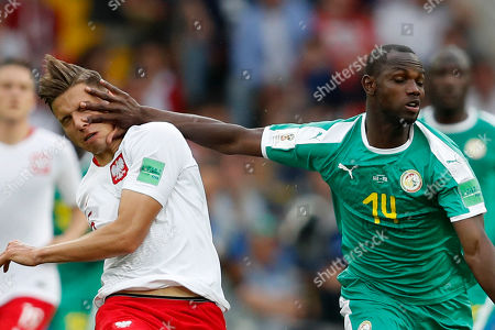 Poland's Jan Bednarek, left, and Senegal's Moussa Konate fight for the ball during the group H match between Poland and Senegal at the 2018 soccer World Cup in the Spartak Stadium in Moscow, Russia