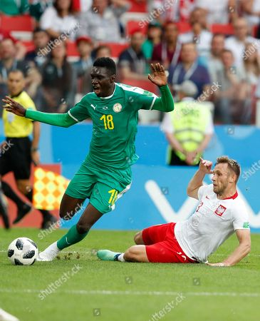 Poland's Jan Bednarek, left, clears the ball past Senegal's Moussa Konate during the group H match between Poland and Senegal at the 2018 soccer World Cup in the Spartak Stadium in Moscow, Russia