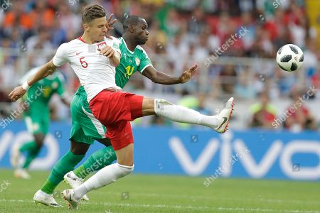 Moussa Konate, Jan Bednarek. Poland's Jan Bednarek, left, challenges for the ball with Senegal's Moussa Konate during the group H match between Poland and Senegal at the 2018 soccer World Cup in the Spartak Stadium in Moscow, Russia