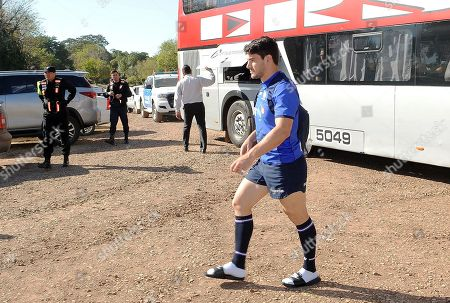 Sam Hidalgo-Clyne walks from the team bus with heaviy armed police looking on as they guard the Scotland squad?s arrival and as they get prepared for training.