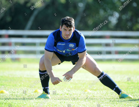 Sam Hidalgo-Clyne - Scotland scrum half stretches off at the start of the session as the players prepare for Saturday's test match against Argentina.