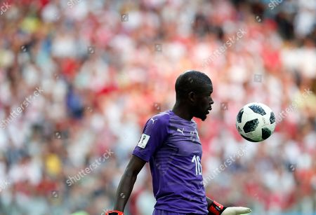 Senegal goalkeeper Khadim Ndiaye tosses a ball during the group H match between Poland and Senegal at the 2018 soccer World Cup in the Spartak Stadium in Moscow, Russia