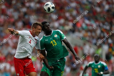 Poland's Thiago Cionek, left, and Senegal's Alfred Ndiaye, right, go for a header during the group H match between Poland and Senegal at the 2018 soccer World Cup in the Spartak Stadium in Moscow, Russia
